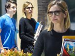 UK CLIENTS MUST CREDIT: AKM-GSI ONLY\nEXCLUSIVE: Calista Flockhart helps her son Liam with a school project at the library in Santa Monica, CA on July 11, 2015.\n\nPictured: Calista Flockhart and Liam Flockhart\nRef: SPL1077270  110715   EXCLUSIVE\nPicture by: AKM-GSI / Splash News\n\n