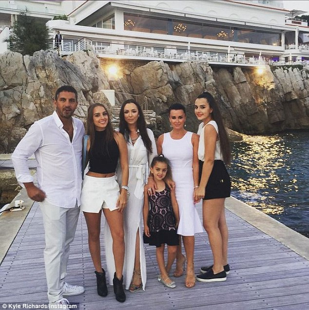 All together: The Bravo reality star and her family have spent the last several days touring the Mediterranean. They're seen here heading out for dinner in St. Tropez last week