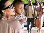 Expecting parents Kim Kardashian and Kanye West take adorable daughter Nori to the movies and shopping in Calabasas, CA. The trio wears matching shades of peach and beige. Pregnant Kim appears a little bit irritable. Sunday, July 12, 2015. X17online.com
