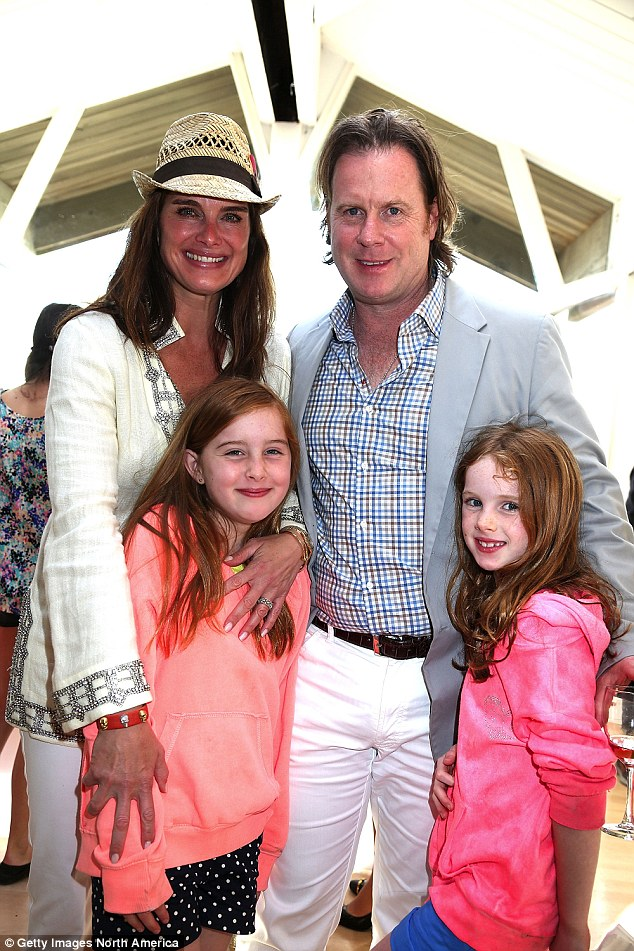 Smile for the cameras: Brooke Shields and her husband Chris Henchy posted with their daughters Rowan (left) and Grier (right) at an event at the Bridgehampton Tennis and Surf Club in 2013