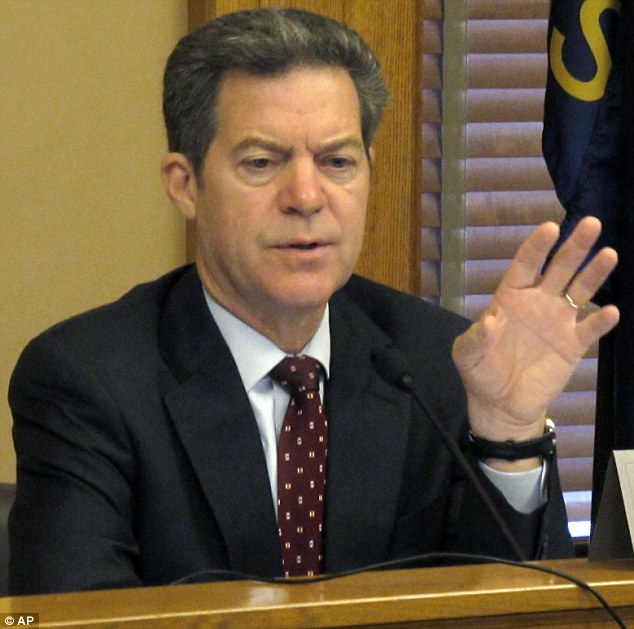 Conservative: Kansas Gov. Sam Brownback said earlier this week that the 'imposition' of gay marriage could lead to 'potential infringements' of religious liberties