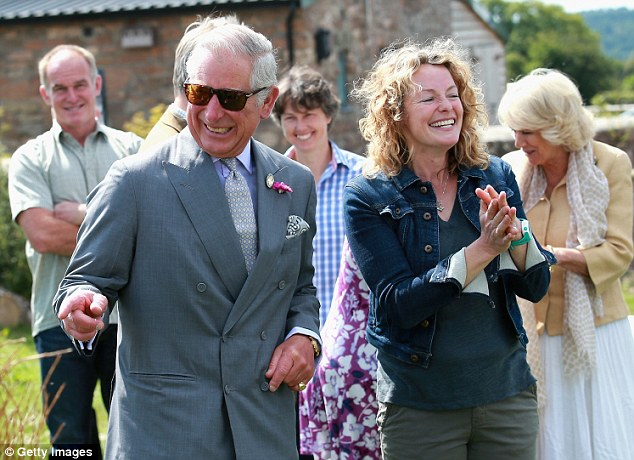 Clearly engrossed in the activities around him, Prince Charles was seem pointing things out as Kate Humble giggled away