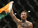 Conor McGregor celebrates after defeating Chad Mendes during their interim featherweight title mixed martial arts bout at UFC 189 on Saturday, July 11, 2015, in Las Vegas. (AP Photo/John Locher)