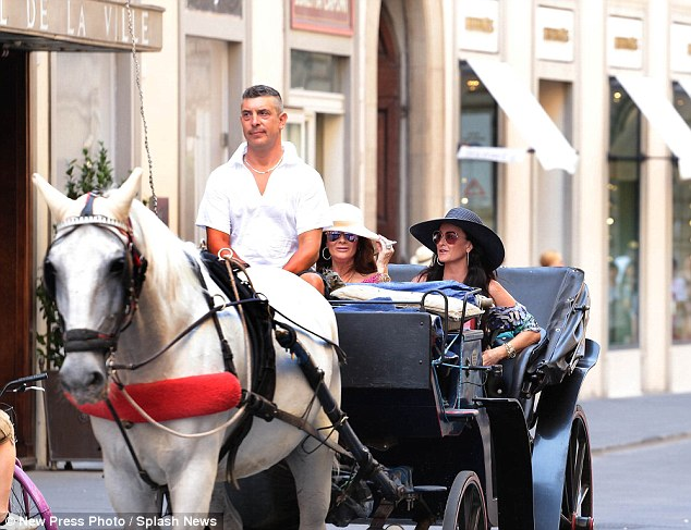 Wheely good time: Kyle Richards was joined on her Italian holiday by fellow Real Housewives star Lisa Vanderpump on Thursday and enjoyed a horse and cart ride in Florence, Italy
