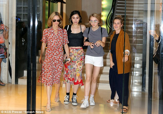 French style: Vanessa, 42, looked sophisticated in a floral shirt dress and gold sandals, while her 16-year-old daughter opted for a simple, street style in T-shirt, shorts and trainers