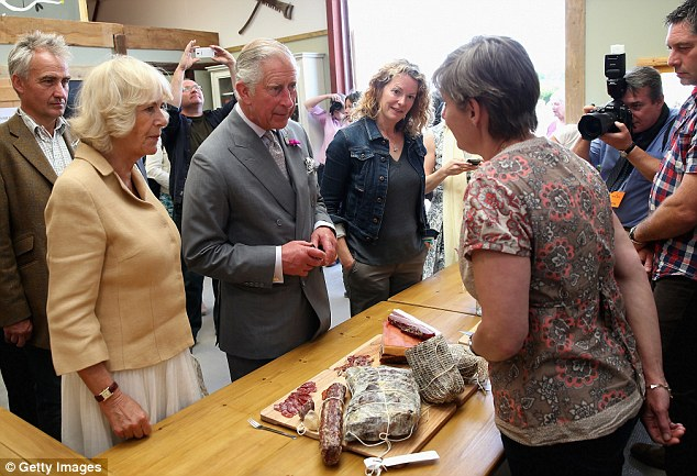 Kate Humble led Charles and Camilla into the farm shop where they were presented with local produce