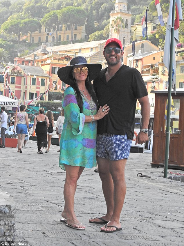 Romantic stroll: Kyle has been enjoying her Italian break with husband Mauricio and the two stopped off in Portofino during their trip