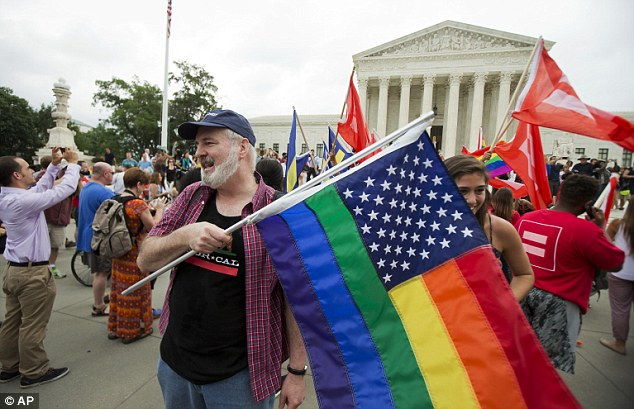 Landmark: Supporters celebrate outside the U.S. Supreme Court in Washington after the court declared that same-sex couples have a right to marry anywhere in the United States on June 26