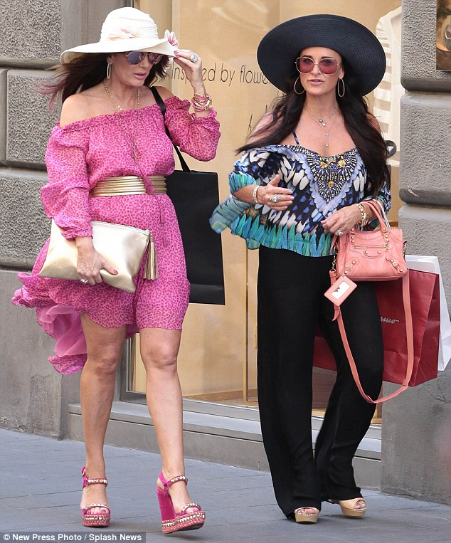 Easy breezy: The wind nearly caused the two women a spot of bother when they stopped to do some shopping