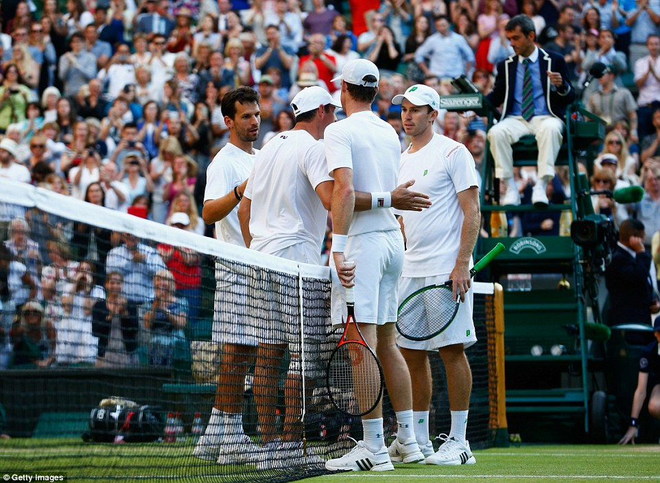 Congratulate: Jamie Murray (second right) receives a pat on the back from opposing doubles team Jonathan Erlich and Phillip Petzschner