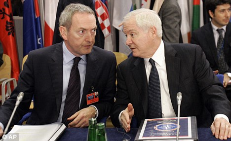 Support bid: U.S. Defence Secretary Robert Gates, right, shares a word with  John Hutton in Krakow - NATO members have failed to offer any further support for coalition efforts in Afghanistan