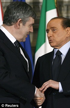 Leaders: Prime Minister Gordon Brown meets his Italian counterpart Silvio Berlusconi before a meeting in Rome. Mr Brown is backing Tessa Jowell over her husband's conviction for receiving a bribe from Mr Berlusconi