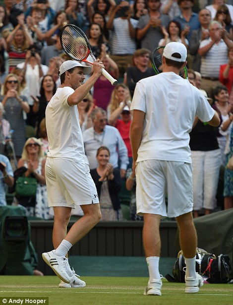 Celebrations: Jamie Murray and John Peers celebrate their win against Jonathan Erlich and Phillip Petzschner at Wimbledon today