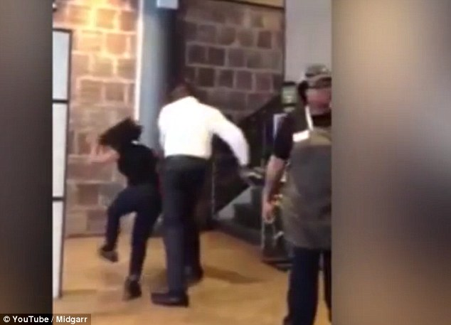 This is the moment that the manager at a New York restaurant hit a female employee