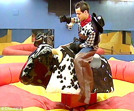 Ride it cowboy: Ben competes in his task, the bucking bronco