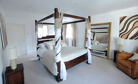 A four-poster bed draped with fabric