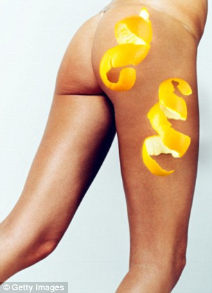 Woman with orange peel over side of leg, low section