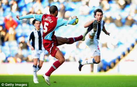 WEST BROMWICH, UNITED KINGDOM - JANUARY 24:  Clark Carlisle (L) of Burnley challenges Filipe Teixeira (R) of West Bromwich Albion during the FA Cup sponsored by E.ON 4th Round m