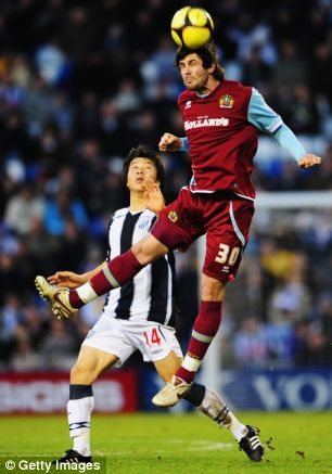 WEST BROMWICH, UNITED KINGDOM - JANUARY 24:  Steven Thompson (R) of Burnley rises above Do-Heon Kim (L) of West Bromwich Albion during the FA Cup sponsored by E.ON 4th Round match between West Bromwich Albion and Burnley at The Hawthorns