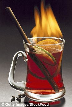 Flaming red wine punch