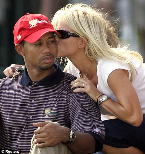 Marital woes: Woods with wife Elin, whom he married in 2004