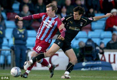 Scunthorpe United's Martyn Woolford (left) and Coventry City's Jack Cork (right) in action