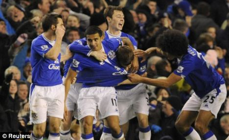 Everton's Tim Cahill celebrates scoring with his team-mates