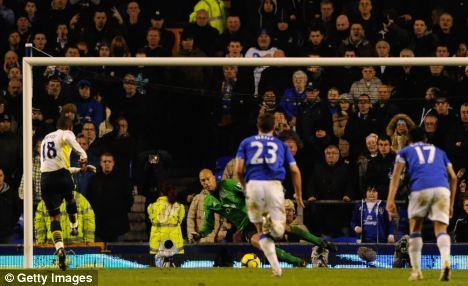 Tim Howard of Everton saves the penalty kick of Jermain Defoe