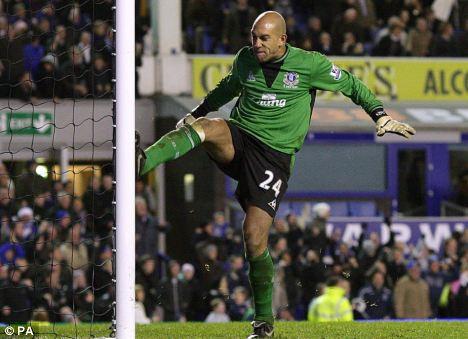 Everton goalkeeper Tim Howard celebrates after saving Jermain Defoe's penalty