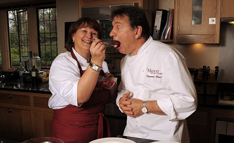 Wendy helps Raymond to some of the food she created during the course
