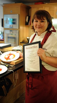 Finished article: Wendy poses with her dish and her cooking certificate
