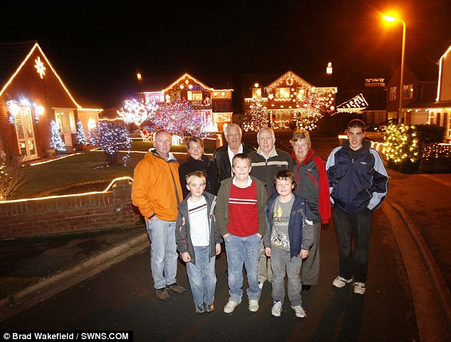 Light work for the neighbourhood: The residents gather to wish a Merry Christmas to passers-by