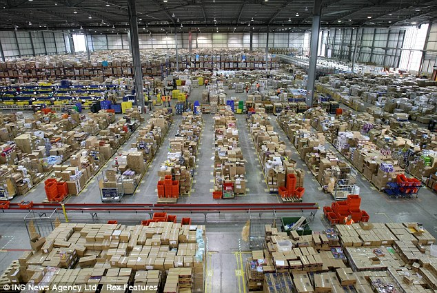 Santa's workshop? No, this is Amazon's warehouse in Milton Keynes, with every inch of it's 540,000 sq ft taken up with presents ready for shipping