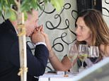 11.JULY.2015 - LONDON - UK *EXCLUSIVE ALL ROUND PICTURES* CHARLES SAATCHI AND TRINNY WOODALL SPEND A LEISURELY AFTERNOON ENJOYING LUNCH OUTSIDE THEIR FAVOURITE RESTAURANT SCOTT�S IN MAYFAIR. THEY CHATTED, HELD HANDS, PLAYED WITH THEIR PHONES AND LOOKED VERY MUCH TOGETHER. AT ONE POINT, CHARLES APPEARED TO BE IN SOME DISTRESS OR DISCOMFORT AS HE COVERED HIS FACE WITH A NAPKIN FOR SEVERAL MINUTES.  AS THEY LEFT TO CATCH A WAITING CAB, CHARLES APPEARED TO GIVE DIRECTIONS TO FELLOW DINERS.  BYLINE MUST READ : XPOSUREPHOTOS.COM ***UK CLIENTS - PICTURES CONTAINING CHILDREN PLEASE PIXELATE FACE PRIOR TO PUBLICATION *** **UK CLIENTS MUST CALL PRIOR TO TV OR ONLINE USAGE PLEASE TELEPHONE 0208 344 2007**