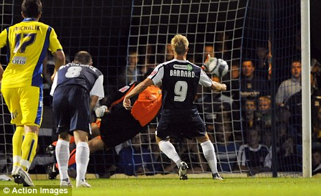 Lee Barnard (R) of Southend has his penalty saved by Shane Higgs of Leeds