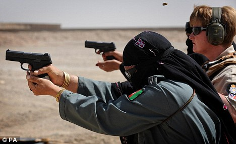 Female Afghan police carrying out weapon training with a Sig Sauer 9 mm pistol in an undated photo. Gordon Brown has said the sooner Afghan forces can maintain security, the sooner British troops can leave