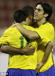 Nilmar is mobbed by Kaka (right)