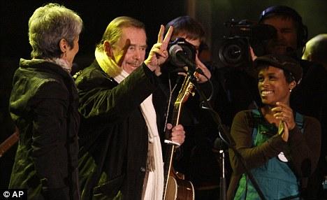 Former Czech Republic president Vaclav Havel greets the crowd at a concert commemorating the Velvet Revolution