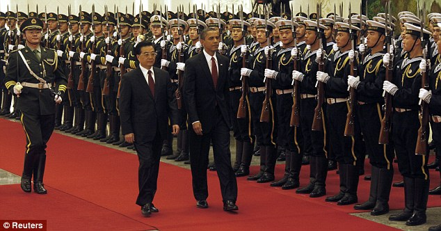 China's President Hu Jintao(centre left) and U.S. President Barack Obama inspect honor guards during a welcome ceremony at the Great Hall of the People in Beijing