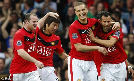 Celebrate good times: Vidic (centre) will be all smiles as he returns to the fold
