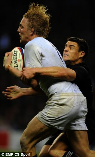 England's Lewis Moody tackled by New Zealand's Dan Carter