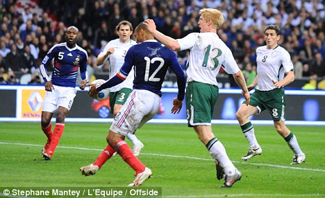 He's a bit handy: Henry sets up Gallas for France's controversial winner in Paris