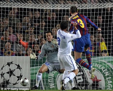 Barcelona's defender Gerard Pique (R) scores against Inter Milan