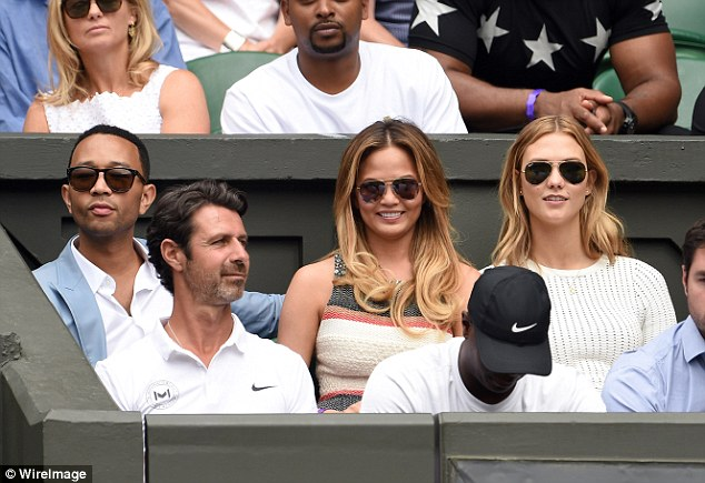 Singer John Legend and models Chrissy Teigen and Karlie Kloss, right, watched Serena's match on Tuesday