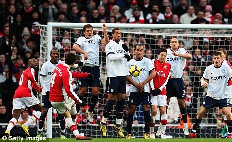 Cesc Fabregas fires Arsenal into the lead with a sumptuous freekick against Aston Villa