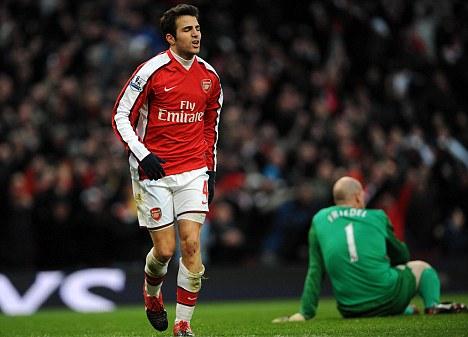 Cesc Fabregas limps away in celebration