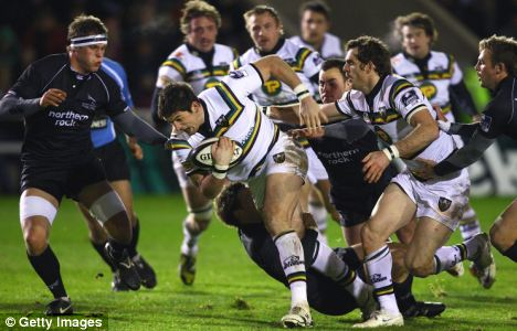 James Downey of Northampton makes a break through the Newcastle Falcons defence