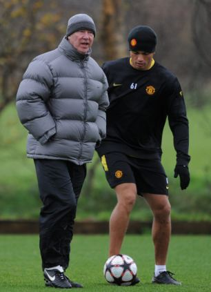 Sir Alex Ferguson of Manchester United looks on in front of Wes Brown