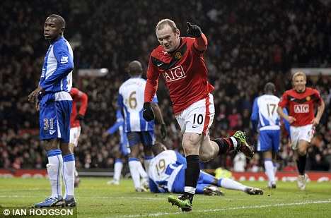 That's for you, boss: Rooney, who produced another brilliant display, celebrates his goal