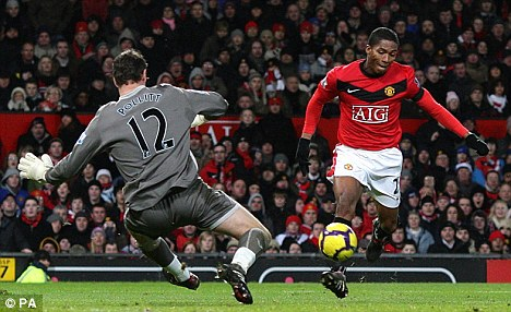 High five: Antonio Valencia completes the rout over his former club to cut down Chelsea's lead at the top of the table